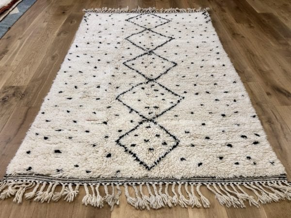 Black dots Moroccan Berber rug on white background