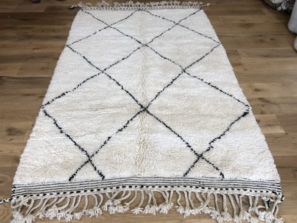 white rug black geometric design